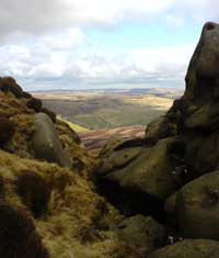 Deep ravines cut into Kinder Scout's northern edge