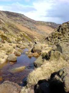 Grindsbrook Clough - an exciting downward scramble in the sunshine